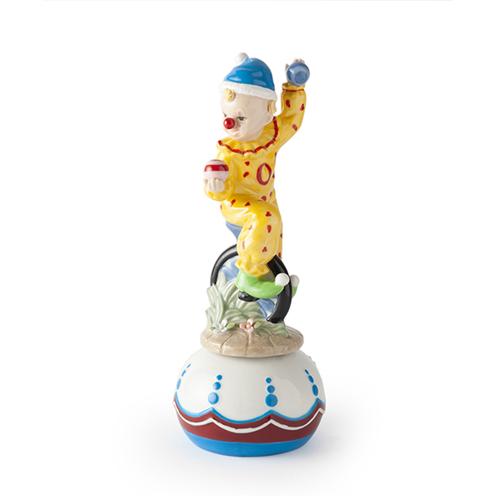 Carillon clown su monociclo royal class by hervit in porcellana misure 22 cm..